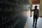 A teacher writes on the blackboard in class at the Loreto Secondary School in Rumbek, South Sudan. The school is run by the Institute for the Blessed Virgin Mary--the Loreto Sisters--of Ireland.