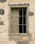 Umm Qais, northwestern Jordan.  A window stands partially closed outside one of the reconstructed Ottoman buildings on the acropolis at the biblical town of Gadara.  © Rick Collier