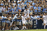 19 September 2014: North Carolina's Tyler Engel (8) celebrates his goal with Jonathan Campbell (2) and fans along the fence. The Duke University Blue Devils hosted the University of North Carolina Tar Heels at Koskinen Stadium in Durham, North Carolina in a 2014 NCAA Division I Men's Soccer match. Duke won the game 2-1.