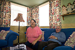 Jim and Christine Gallagher in the living room of their prefab at the Excalibur estate in Catford, South London. Their prefab has been listed this year by the English Heritage. There are 6 of them which were recently listed by the English Heritage among the 187 on the estate. Thousands of post-war prefabs are still being lived in and cherished by their tenants or owners all over the UK.