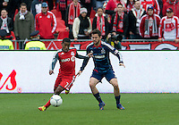 21 April 2012: Toronto FC forward Joao Plata #7 and Chicago Fire defender Dan Gargan #3 in action during the second half in a game between the Chicago Fire and Toronto FC at BMO Field in Toronto..The Chicago Fire won 3-2...