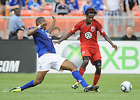 DC United forward Joseph Ngwenya (11)  goes against Everton defender Sylvain Distin (15)    Everton defeated DC United 3-1 in a international friendly ,at RFK Stadium, Saturday July 23, 2011.