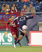 New England Revolution defender Darrius Barnes (25) collects errant pass as Real Salt Lake forward Fabian Espindola (7) pressures. Real Salt Lake defeated the New England Revolution, 2-1, at Gillette Stadium on October 2, 2010.