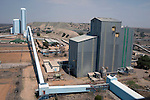 JWANENG, BOTSWANA - SEPTEMBER 24: An overview of the pit and processing plant at Jwaneng, the richest diamond mine in the world on September 24, 2009 in Jwaneng, Botswana. It's owned by Debswana, a partnership between the De Beers Company and the government of Botswana. The mine employs about 3000 people and is also processing ore for the mine as well as two of Debswana's other mines. The truck can carry about 245 tons of ore each time. The mine operates 24 hours a day, all year around. Diamond wealth has brought lots of revenues to Botswana, including an impressive infrastructure such as roads and free education up to university. (Photo by Per-Anders Pettersson)...