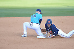 Ole Miss' Tanner Mathis (12) beats the tag from North Carolina-Wilmington' Jake Koenig (18) at second base at Oxford-University Stadium in Oxford, Miss. on Friday, February 24, 2012. Mathis reached base on an error. He later scored on an Auston Bausfield single. Ole Miss won 2-0.