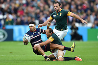 Folau Niua of the USA is tackled by Fourie du Preez of South Africa. Rugby World Cup Pool B match between South Africa and the USA on October 7, 2015 at The Stadium, Queen Elizabeth Olympic Park in London, England. Photo by: Patrick Khachfe / Onside Images