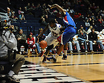 Ole Miss' Nick Williams (20) is fouled by SMU's Shawn Williams (2) at the C.M. &quot;Tad&quot; Smith Coliseum in Oxford, Miss. on Tuesday, January 3, 2012. Ole Miss won 50-48.