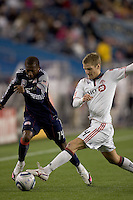 New England Revolution midfielder Sainey Nyassi (14) brings the ball down wing as Toronto FC defender Raivis Hscanovics (34) defends. The New England Revolution defeated Toronto FC, 4-1, at Gillette Stadium on April 10, 2010.