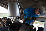 Mitchell Baalman inspects the pump for a center pivot irrigation system on his 12,000-acre farm outside of Hoxie, Kan., on Thursday, Oct. 11, 2012. As historically dry conditions continue, farmers from South Dakota to the Texas panhandle rely on the Ogallala Aquifer, the largest underground aquifer in the United States, to irrigate crops. After decades of use, the falling water level ? accelerated by historic drought conditions over the last two years ? is putting pressure on farmers to ease usage or risk becoming the last generation to grow crops on the land. Farmers like Mitchell Baalman and Brett Oelke (not pictured) are part of a farming community in in Sheridan County, Kansas, an agricultural hub in western Kansas, who have agreed to cut back on water use for crop irrigation so that their children and future generations can continue to farm and sustain themselves on the High Plains.