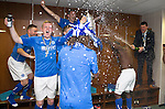 St Johnstone v Dundee United....17.05.14   William Hill Scottish Cup Final<br /> Manager Tommy Wright sprays his players with champagne as they celebrate in their dressing room<br /> Picture by Graeme Hart.<br /> Copyright Perthshire Picture Agency<br /> Tel: 01738 623350  Mobile: 07990 594431