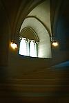 Stairs upward and gothic window
