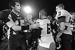 Photo by Jenna Watson<br /> Congratulations are exchanged on the field after the Eagles fell to the Bulldogs Friday, Oct. 11, 2013.