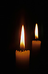 Two lit candles in dark room Marysville Washington State USA