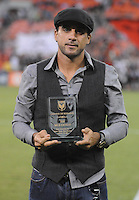 D.C. United forward Dwayne de Rosario (7) gets a plaque commemorating his 100 MLS goals. D.C. United defeated The New England Revolution 2-1 at RFK Stadium, Saturday September 15, 2012.
