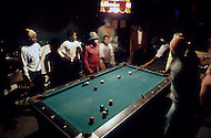 Americus, GA. December 1976.<br /> Unemployed black people playing pool in a club in Americus.<br /> Southerner Jimmy Carter is going to the White House. Born in Georgia, Carter is a democrat with a more open mind. A man who favors racial integration inspite of a majority of white people still living under misserable conditions. Officially, social barriers have been dropped, but racism still exists. If the South is on the rise and if in Georgia average salaries have trippled in the last 15 years, not everyone is benefitting from this economic boom. Perhaps, Jimmy Carter will seriously consider those who are in the lower end of the system's social scales.