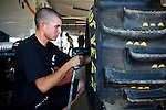 Geoff Gill installs his paddle tire at the National Sand Drad Race Association's 2009 Summer Nationals in Avenal, CA May 17, 2009.