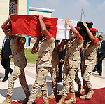 Egyptian military pallbearers carry the flag draped coffin of Hisham Barakat, the top judicial official in charge of overseeing the prosecution of thousands of Islamists, including former President Mohammed Morsi, at his funeral in Cairo, Egypt, Tuesday, June 30, 2015. The Egyptian president promised to speed up proceedings against extremists by amending laws and freeing up the judiciary, a day after the country s top prosecutor was killed in a car bombing. Photo by Egyptian Presidency / apaimages