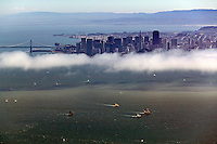 aerial photograoh sailboat racing San Francisco bay San Francisco skyline and bay bridge in background
