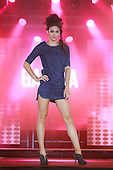 A model wearing a short blue dress for the Garcia fashion show held during the Moda Sotto le Stelle event in little Italy in Montreal