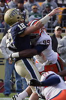 Syracuse defensive end Chandler Jones (99) puts a hit on Pitt quarterback Tino Sunseri (12). The Pittsburgh Panthers beat the Syracuse Orange 33-20 at Heinz Field in Pittsburgh, Pennsylvania on December 3, 2011
