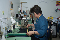 seamstress measuring a dress top