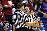 22 March 2014: Referee Tiara Cruse (right) confers with Eric Koch (left). The DePaul University Blue Demon played the University of Oklahoma Sooners in an NCAA Division I Women's Basketball Tournament First Round game at Cameron Indoor Stadium in Durham, North Carolina. DePaul won the game 104-100.
