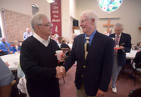 NWA Democrat-Gazette/BEN GOFF @NWABENGOFF<br /> Pastor Fred Nelson (left) talks with church member Bob McNew on Sunday May 29, 2016 during a retirement reception for Nelson at United Lutheran Church in Bella Vista. Nelson was the pastor of the church for over five years before stepping down in 2009 to serve as interim pastor for other congregations. Nelson served his last day in the pulpit at United Lutheran earlier in May after returning to serve as interim pastor for the congregation over the past 18 months.