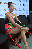 """Daria Dmitrieva of Russia smiles from """"kiss & cry"""" after performing in hoop Event Finals at 2010 World Cup at Portimao, Portugal on March 14, 2010.  (Photo by Tom Theobald)."""