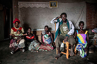 Witchdoctor Arnaldo Rodis, (45), with four of his six wives (from left to right): Lidia (30), Augusta (25), Lutina (26) and Gina (16). Arnaldo had nine children. He died from malaria in May 2011.