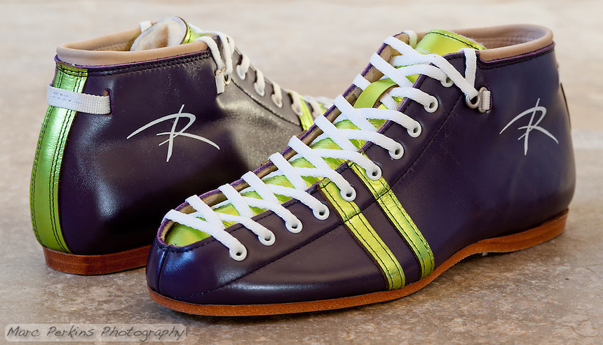 Michelle's new custom Riedell 495 roller skate boots.  She used Riedell's color lab to create this pair: the base leather is purple, the highlights are lime laminate leather, and the eyelets and writing are white.  Once a magnesium Avenger plate is added, they'll be ready to roll!