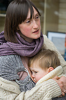 A mother breastfeeds her 15 month old boy who is in a sling.<br /> London, England, UK<br /> 22-03-2015<br /> <br /> &copy; Paul Carter / wdiip.co.uk