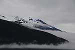 snow cap mountains shrouded in the mist on the southern coast of Alaska