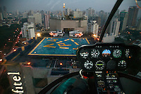A young couple land on the Sofitel helipad after a 17 minute flight above Sao Paulo. They will then have a special dinner and a romantic night at the hotel. This service, called Night Air is one of the many types of helicopter use becoming increasingly popular in Sao Paulo. .
