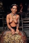 00075_10, Kiangan, Philippines, 1985, PHILIPPINES-10019. A woman peels beans.<br /> <br /> Portraits_Book<br /> PORTRAITS_book<br /> retouched_Sonny Fabbri