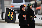 IRAQ, SULAIMANIYAH:  A girl holds a flag of mourning during Ashura...Around 500 hundred worshipers, many of them internally displaced Arabs, celebrated the Shia holiday of Ashura--the mourning of the death of the grandson of the Islamic prophet Mohammed.  ..Photo by Kamaran Najm/Metrography
