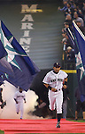 Seattle Mariners right fielder Ichiro Suzuki, of Japan, runs down the red carpet as he's introduced during opening ceremonies before the opening home game of the season with the Oakland Athletics at SAFECO Field in Seattle April 12, 2010.  During pregame ceremonies, Suzuki received his 9th consecutive Golden Glove and his  third Silver Slugger Awards. The Mariners open a three-game homestand against the Oakland Athletics.  Jim Bryant Photo. &copy;2010. ALL RIGHTS RESERVED.