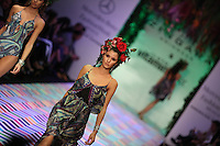 models displays creations by Zingara, during the Mercedes Benz Fashion Week Mexico Spring/Summer 2015, in Mexico City, 10.01.2014. VIEWpress / Miguel Angel Pantaleon