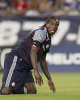 New England Revolution midfielder Shalrie Joseph (21) looks to assistant referee for a signal after ball appears to have passed over goal line. In a Major League Soccer (MLS) match, Chivas USA defeated the New England Revolution, 3-2, at Gillette Stadium on August 6, 2011.