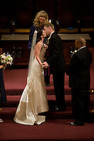 A bride and groom kiss during their wedding in Westminster Presbyterian Church in Sacramento, California.