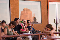 Tourists enjoy the scenery outside the gift shop at the new View Hotel at Monument Valley Navajo Tribal Park in southern Utah. The park, operated by teh tribe, was once a popular set for western films of the 1930s through 60s. It is immensely popular among European tourists. (Kevin Moloney for the New York Times)