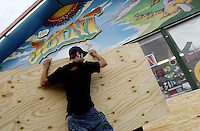 PANAMA CITY BEACH, FL. 8/11/04-Billy Wiehl of Panama City helps unload plywood to cover the windows of The Joint, a shop in Panama City Beach as the store's owner prepares for Hurricane Bonnie Wednesday in Panama City Beach. COLIN HACKLEY PHOTO