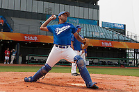 17 August 2007: Catcher Jamel Boutagra practices during the Good Luck Beijing International baseball tournament (olympic test event) at the Wukesong Baseball Field in Beijing, China.