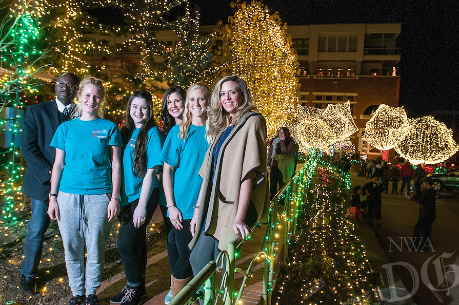 NWA Democrat-Gazette/ANTHONY REYES &bull; @NWATONYR<br /> Godwin-Charles Ogbeide, (from left) hospitality professor for the University of Arkansas, with hospitality students Rosa Weinhold, Lauren Simpson, Melanie Grubb, Allie Coss, and Ashley Byrd, graduate assistant, Wednesday, Dec. 9, 2015 on the Fayetteville square. Hospitality students organized the opening ceremony for the Lights of the Ozarks.