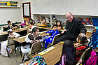 Oct. 4, 2013; Rev. Timothy Scully, C.S.C. chats with fourth grade students at St. Rita School in Ft. Worth, TX.  The Alliance For Catholic Education (ACE) kicked off its Fighting For Our Children&rsquo;s Future National Bus Tour during the Shamrock Series events in Dallas and Fort Worth.<br /> <br /> Photo by Matt Cashore/University of Notre Dame
