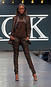 A model poses on the runway during the KQK  fashion show held during the Fashion and Design Festival  in downtown Montreal