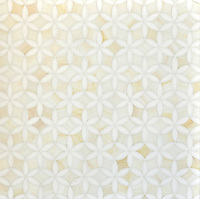 Fiona, a jewel glass waterjet mosaic, is shown in Absolute White and Quartz.
