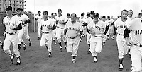 San Francisco Giants 1968 Spring Training in Casa Grande, Arizona. The team running is led by the manager Herman Franks (center no hat)..(photo 1968 by Ron Riesterer)