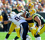 Green Bay Packers' Brett Favre is sacked by San Diego Chargers' Igor Olshansky for a 5-yard loss in the 3rd quarter. .The Green Bay Packers hosted the San Diego Chargers at Lambeau Field in Green Bay Sunday September 23, 2007. Steve Apps-State Journal.