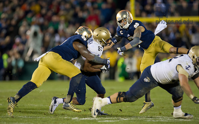 Nov. 2, 2013; Linebacker Jaylon Smith (9) and cornerback Bennett Jackson (2) tackle Navy wide receiver Shawn Lynch (87) on Navy's final play of the game.<br /> <br /> Photo by Matt Cashore