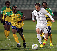 Solomon Islands' Nelson Sale Kilifa chases New Zealand's Michael McGlinchey for the ball in a FIFA World Cup Qualifier Match, North Harbour Stadium, Auckland, New Zealand, Tuesday, September 11, 2012.  Credit:SNPA / David Rowland